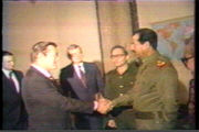 Rumsfeld, at the time Ronald Reagan's special envoy to the Middle East, meeting with Saddam Hussein during a visit to Baghdad, Iraq in December, 1983, in the midst of the Iran-Iraq War. In later years, this image would be strongly downplayed by Rumsfeld and highlighted by his opponents, as relations with Hussein's regime deteriorated. (Video frame capture; see the complete video here.)